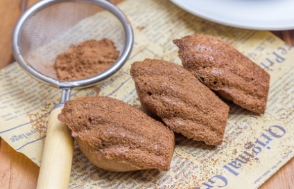 Cocoa powdered choco madeleines on the news paper