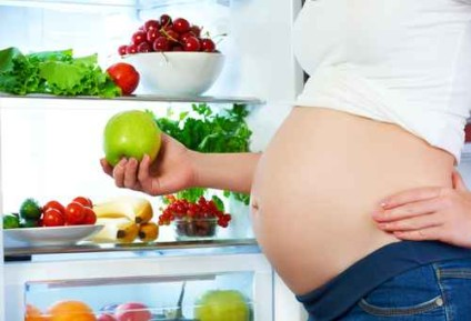 nutrition and diet during pregnancy. Pregnant woman with fruits